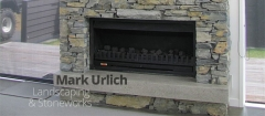 Inside stone fireplace by Mark Urlich Landscaping & Siteworks